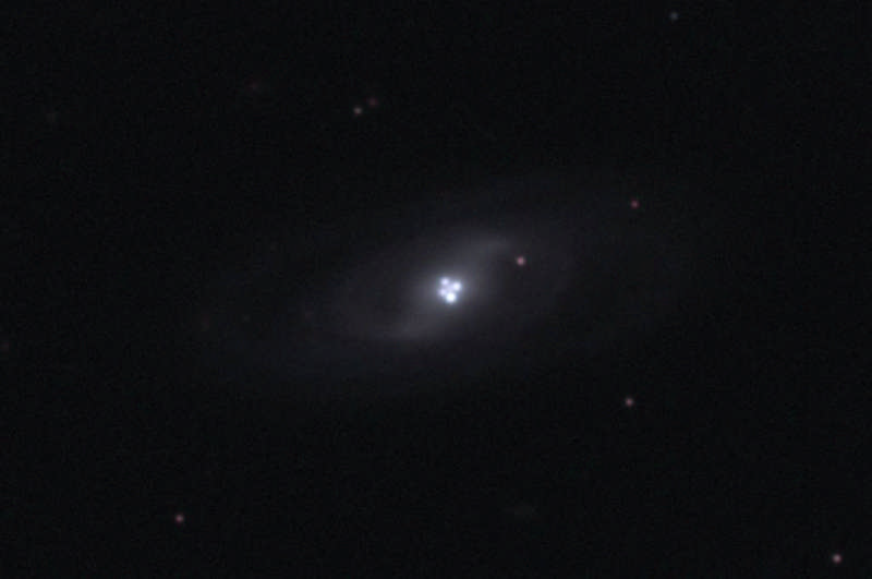 The Einstein Cross Gravitational Lens